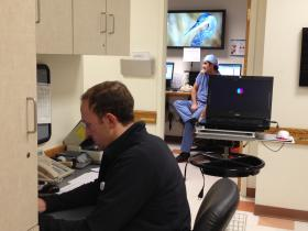Brian Drolet, MD preps for a busy day in the Rhode Island Hospital surgery clinic.
