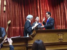 Justice Alice Gibney administering the oath of office to Speaker Fox at the start of the 2013 session