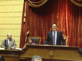 House Speaker Gordon Fox beams from the rostrum shortly after the bill passed.