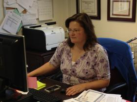 Dr. Staci Fischer at her desk at Rhode Island Hospital.