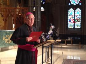 Bishop Thomas Tobin reads his statement on news that the pope was stepping down