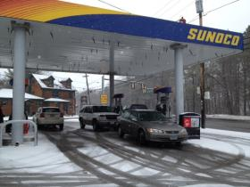 Cars at RI Gas Station Pumps