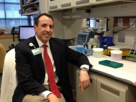 Rhode Island Hospital researcher Jason Aliotta in his lab