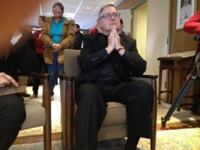 Bishop Thomas Tobin watches closely as the new pope is introduced to the world.