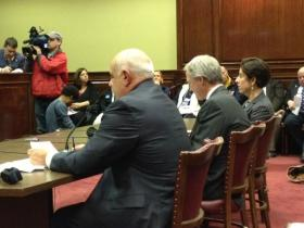 Senator Frank Ciccone, Governor Lincoln Chafee, and Treasurer Gina Raimondo at the witness table.