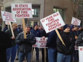 Firefighters protest Treasurer Gina Raimondo's keynote speech at a conference in downtown Providence.