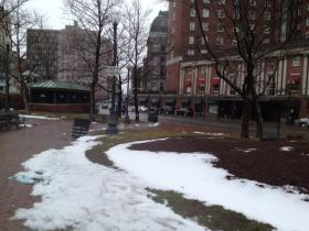 A wet snow falls on downtown Providence Thursday afternoon.