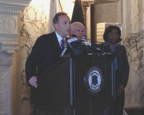 Secretary Steven Costantino, left, and Director Sandra Powell, far right, at a Wednesday press conference on the Ken Block report.