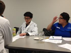 A medical student and a nursing student in an ethics case study workshop at Brown