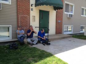 Reporters wait outside the home of a Rhode Island man with connections to one of the Boston bombing suspects.