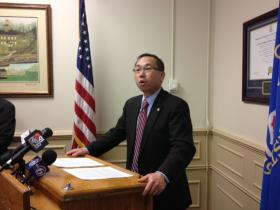 Cranston Mayor Allan Fung announces a pension deal at city hall Monday.