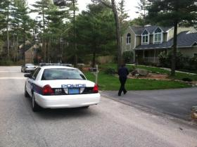 Katherine Russell's mother Judith talks with North Kingstown Police patrolling the block Saturday evening.