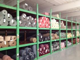 Rolls of fabric line the walls at Colonial Mills in Pawtucket