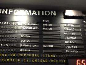 Passengers face delays at the Providence Amtrak station.