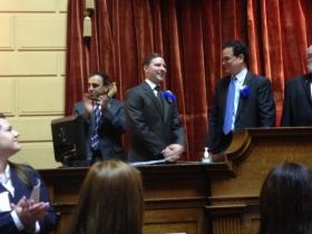 Speaker Fox with his parner, Marcus LaFond (center), during Fox's most recent swearing-in, in January