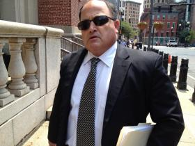 Ralph Mariano leaves the federal courthouse in Providence Thursday after pleading guilty to three felonies in a Navy kickback scheme.