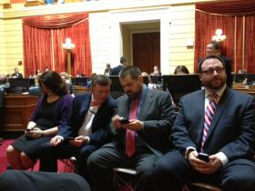 Driscoll (second from right) confers with Bill Fischer during the final House vote on same-sex marriage.