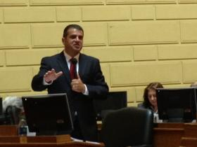 House Finance chairman Helio Melo speaks in support of the House's economic development package.
