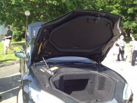 A Tesla owned by Rhode Island resident Don Wineberg shows nothing but storage space under the hood of the electric car.