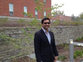 URI pharmacy professor and researcher Navindra Seeram tours the new medicinal garden.