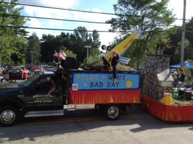 "The ""Bad Day"" float, featuring plane crashes and alligator attacks, was part of the Ancients and Horribles parade in Chepatchet."