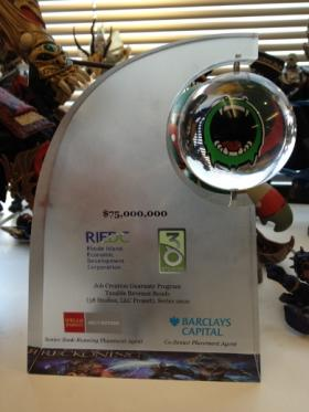 This desk trophy commemorating the 38 Studios $75 million loan was auctioned off after the company went bankrupt.