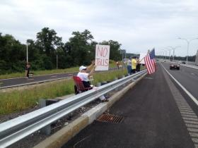 Protestors camped out on the Sakonnet River Bridge to protest the implementation of tolls.