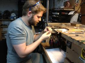 Patrick McMillan of Providence makes custom jewelry in his basement workshop.