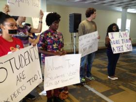 Students protest at the Board of Education retreat.