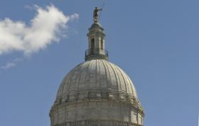 The independent man, who stands atop the RI statehouse, may need to climb down and join a union.