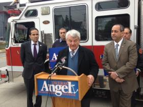Paul Reed, center, offers an endorsement to Taveras outside a Cranston fire house.