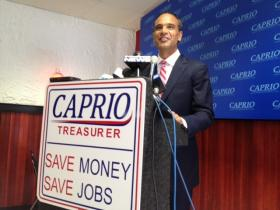 Frank Caprio announces his bid for state treasurer at a Federal Hill pizza parlor.