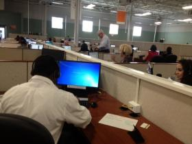 Employees taking calls at HealthSource RI's call center in Rhode Island.