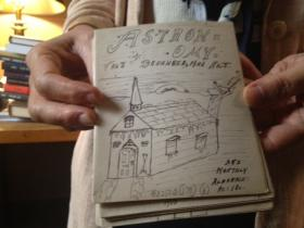 Brown librarian Holly Snyder holds one of HP Lovecraft's hand-drawn pamphlets.