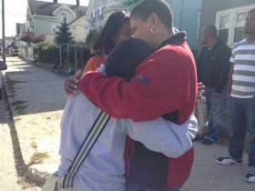 Mother of missing woman, Luisa Pena is consoled by friends.
