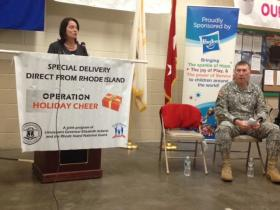 Lt. Gov. Elizabeth Roberts and Maj. Gen. Kevin McBride roll out Operation Holiday Cheer at the RI National Guard Armory in Warwick.