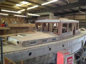 One of two wooden boats being pieced back together at Shannon Marine in Bristol, RI.