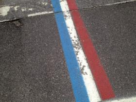 The iconic tri-colored highway divider, which is painted the length of the parade route through Bristol.