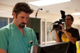 """Production still of an ER resident and director of the film """"The Waiting Room."""""""