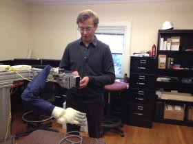 Brown's John Davenport operates BrainGate's robotic arm