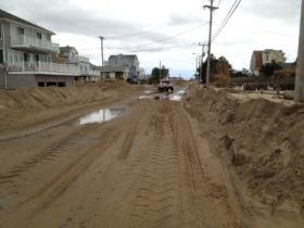 Tons of sand filled Atlantic Ave. in Westerly after Superstorm Sandy raked along the coast.