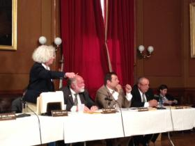 Ajello (left) speaking to Christopher Young during a committee vote on same-sex marriage