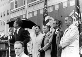 22 November 1963  Trip to Texas. President Kennedy speaks at parking lot rally. L-R: President Kennedy, [unidentified], Senator Ralph W. Yarborough, Governor John Connally, Vice President Johnson. Fort Worth, Texas