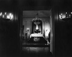 President John F. Kennedy's flag-draped casket lies in state in the East Room of the White House, Washington, D.C. Two members of the honor guard attend the casket