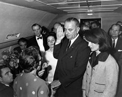 Judge Sarah T. Hughes administers the Presidential Oath of Office to Lyndon Baines Johnson aboard Air Force One, at Love Field, Dallas Texas.