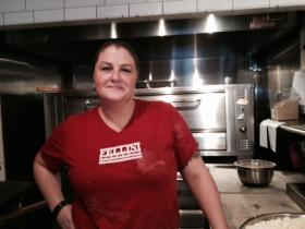 Kristy Knoebler, owner of Fellini's, gearing up for a long day of Thanksgiving pizzas.