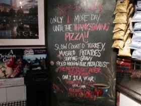 Sign announcing the imminent arrival of the Thanksgiving pizza.
