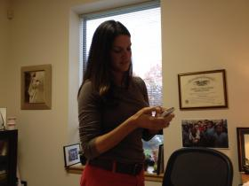 Edesia founder Navyn Salem checks her messages at the end of a busy day.