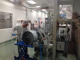 Feeding the foil wrapper into the packaging and production line
