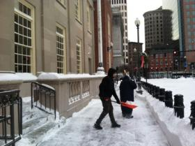 Paul Caminero spent his Friday morning shoveling the sidewalk in front of the federal courthouse in downtown Providence.